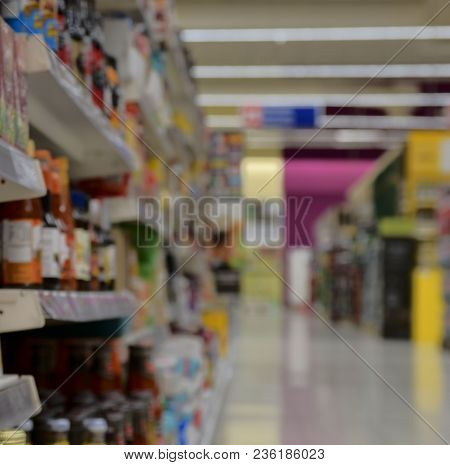 Blurred Section At Retail Store In Europe.  Aisle In Local Supermarket, Defocused Background.