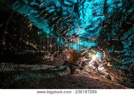 Ice Cave In Vatnajokull, Iceland.the Beauty Of The Caves Filled With Blue Ice.