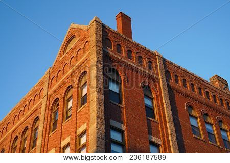 Low Angle View Of Ancient Brick Wall Building Under Sunlight