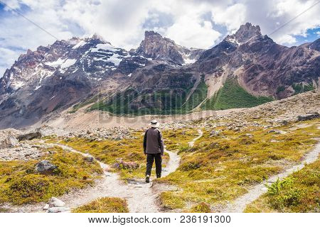 Young Man Taking A Choice, Making A Decision, About What Way To Take, With Three Options Of Path Tha
