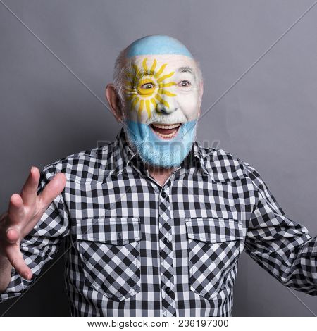 Portrait Of Happy Man With The Flag Of Argentina Painted On His Face. Football Or Soccer Team Fan, S