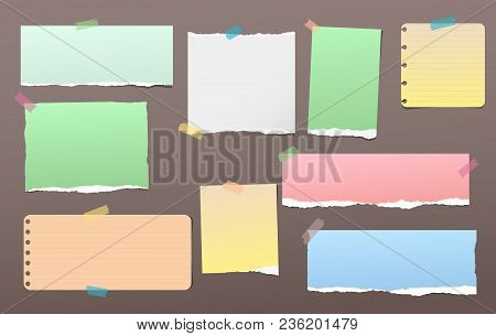 Torn Colorful Note, Notebook Paper Pieces For Text Stuck With Sticky Tape On Dark Brown Background.