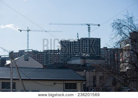 Building Rises Above Low-rise Buildings In The City
