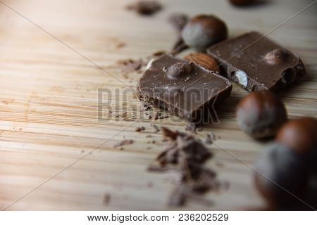 Cracked Chocolate Pile On Dark Background With Shallow Depth Of Field Close Up