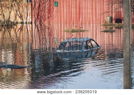 Russia, Balashov April 14, 2018. Flooded During The Spring Disaster To The Roof Car Before The Gates