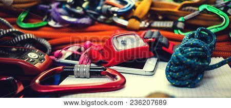Phone, Rope, Navigator, Carbine And Flashlight. Equipment For Mountaineering. Notebook And Equipment
