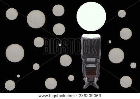 Black Photographic Speedlight On Black Background With White Circles