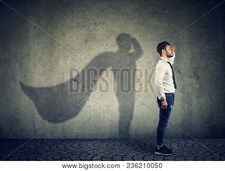Side View Of A Man Imagining To Be A Super Hero Looking Aspired.
