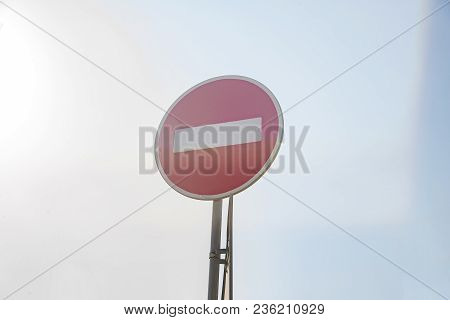 Road Sign-do Not Pass With Lens Flare On Blue Sky On The Background