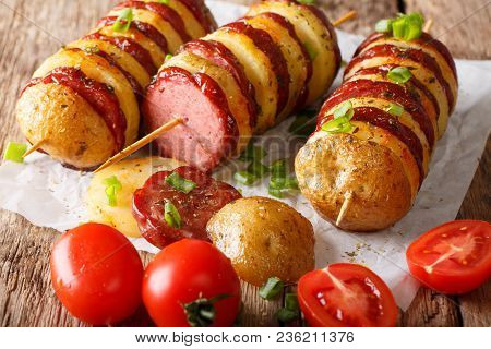 Tasty Bbq From Potato Skewers With Sausage Salami And Tomatoes Closeup On The Peper. Horizontal