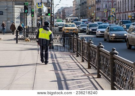 Russian Police Officer Patrolling The Street, Saint-petersburg, April 14 2018