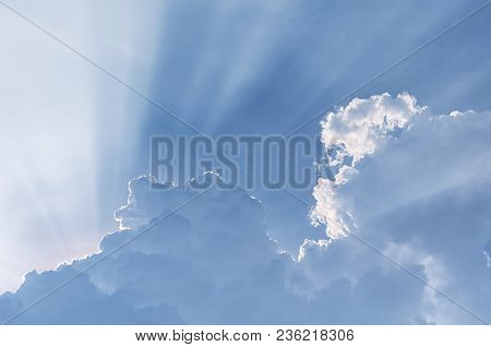 Sun Light Beams Escaping Behiind Large White Puffy Clouds In Vietnam In Southeast Asia.