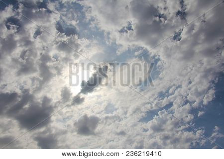Beautiful White Clouds, Sun And Blue Sky As Background.