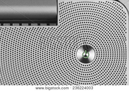 Metal Green Power Io Button On The Aluminium Perforated Surface