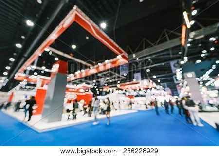 Blur, Defocused Background Of Public Exhibition Hall. Business Tradeshow, Job Fair, Or Stock Market.
