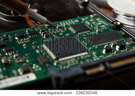 Closeup Of Soldering Of Electronic Circuit Board. Electronic Manufacturing And Repair Concept With S