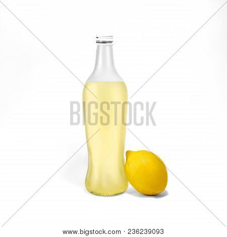 Transparent Glass Bottle With Lemonade And One Whole Lemon Near Are Standing On White Background Pho