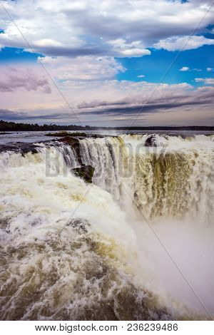 The Devil's throat /Garganta del Diablo/ in grandiose waterfalls Iguazu in the rainy season. The most full-flowing waterfall in the world. Concept of active and ecological tourism