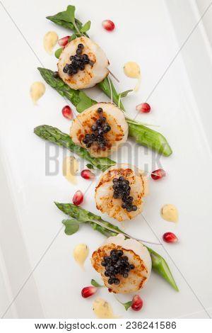 Scallops And Black Caviar