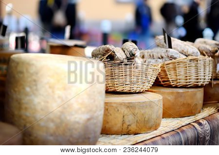 Variety Of Organic Cheeses And Home Made Sausages On Farmer Market In Strasbourg, France. Typical Eu