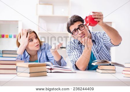 Two students checking savings to pay for education