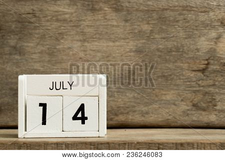 White Block Calendar Present Date 14 And Month July On Wood Background