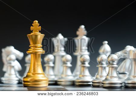 Gold King Chess Piece Face Another Silver Team On Black Background
