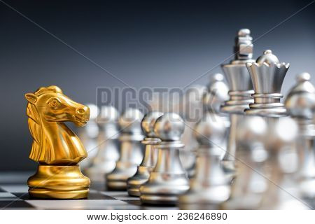 Gold Horse Chess Piece Face Another Silver Team On Black Background