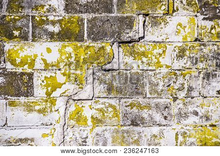 Old Brick Wall With Cracks And Chipped Paint