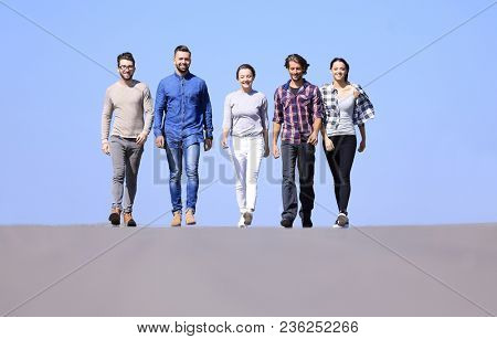 team of confident friends go ahead