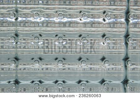 Close Up Detail Of Glass Block Window Background In Nature Light