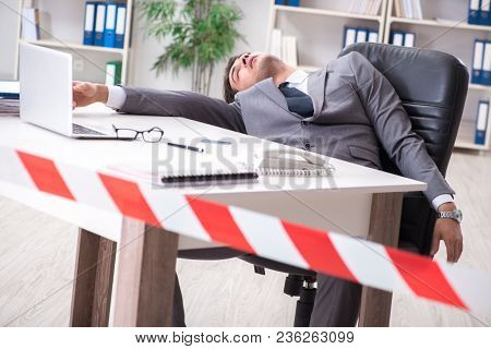 Dead businessman at this desk
