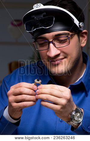 Jeweler working in his workshop late at night