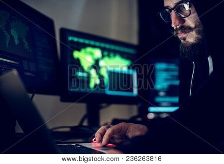 Hacker working using computer with codes