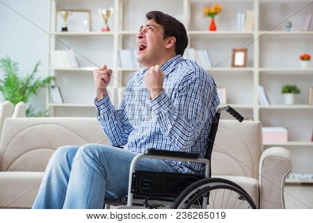 Disabled young man suffering at home