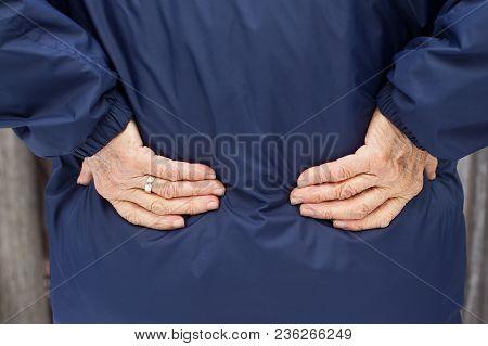 Back View - Elderly Woman Holding Her Waist, Having Acute Backache