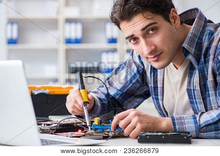 Computer hardware repair and fixing concept by experienced techn