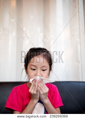 Young Asian Girl Wiping Her Mouth After Snack