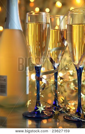 Champagne in glasses on gold background
