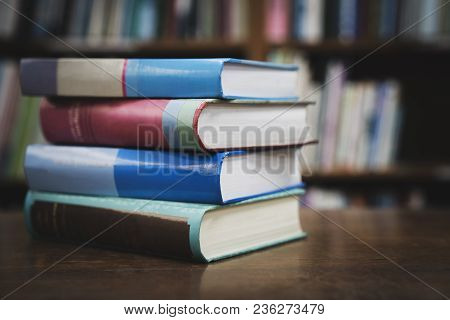 Book Stack In The Library Room And Blurred Bookshelf For Business And Education Background, Back To