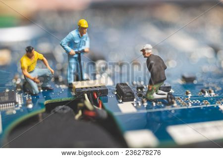 Miniature People : Worker Team Of Engineers Repairing Keyboard Computer Laptop