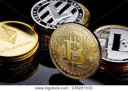 Conceptual Image Of Different Cryptocurrency With Bitcoins On Dark Table, Close-up, Selective Focus,