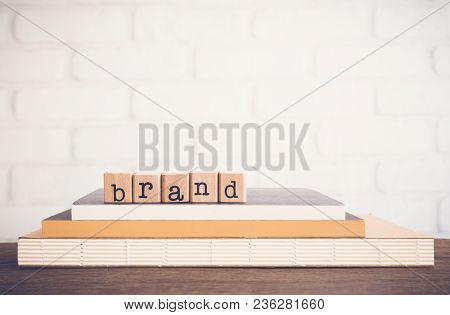 The Word Brand, Text On Wooden Cubes On Top Books. Background Space, Vintage Minimal. Name, Term, De