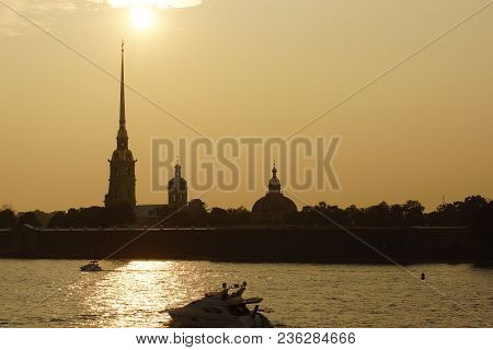 Silhouette Of The Peter And Paul Fortress In St. Petersburg Against The Background Of The Neva River