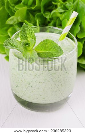 Fresh Green Spinach Smoothie Drink With Straw, Twig Mint, Salad On Soft White Wood Table, Closeup. S