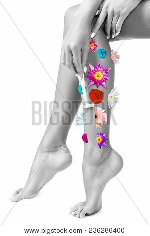 Woman Shaves Legs In Flowers.
