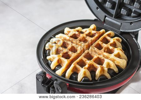 The Process Of Making Homemade Waffles. Freshly Baked Waffles In A Waffle Iron.