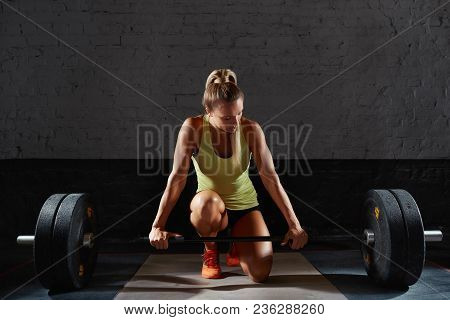 Fitness Woman In The Gym. Horizontal Shot Of Blonde Attractive Young Fitness Woman Preparing To Work