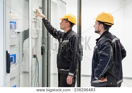 Field Service Crew Testing Electronics Or Inspecting Electrical Installation System