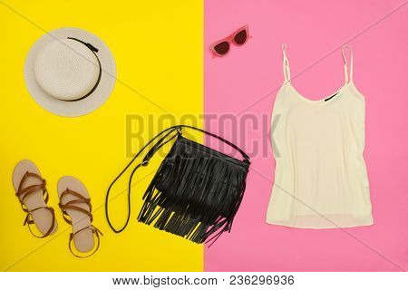 Female Wardrobe. Top, Handbag, Sandals And Hat. Pink And Yellow Background. Fashion Concept